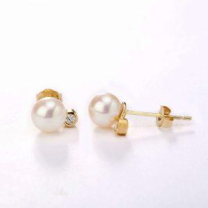 white pearls and diamond earrings